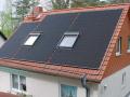 Aquecimento de piscinas com coletor em telhado com claraboias
